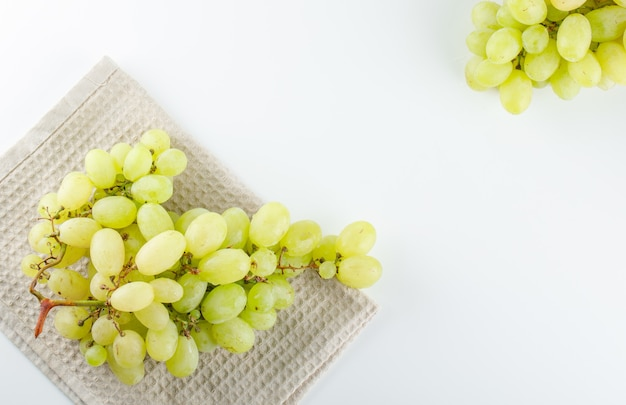 Free Photo Green Grapes On White And Kitchen Towel