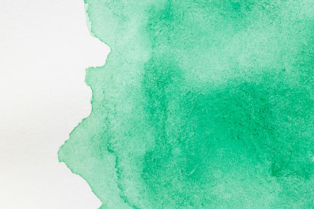 Green hand painted stain on white surface Free Photo