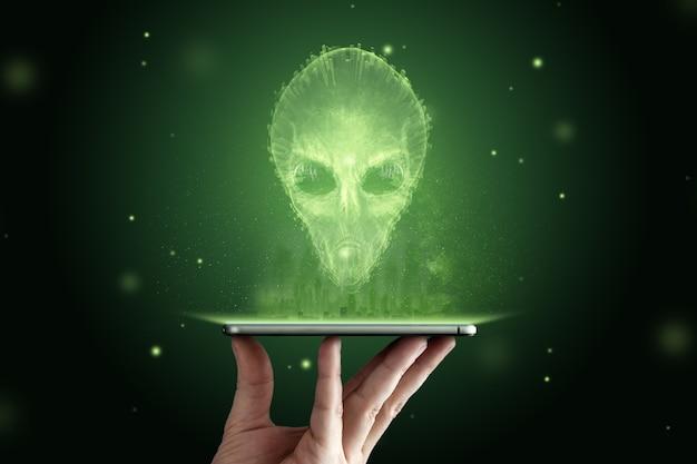 Зеленоголовый инопланетянин с большими черными стеклянными глазами. концепция нло, инопланетяне, контакт с внеземной цивилизацией. Premium Фотографии