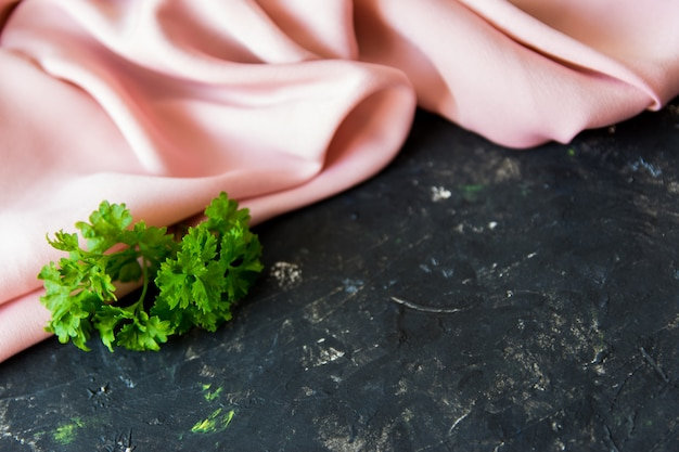 Green herbs on the texture table. Premium Photo