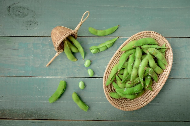 Green japanese soybean in wooden bowl on table wood Premium Photo