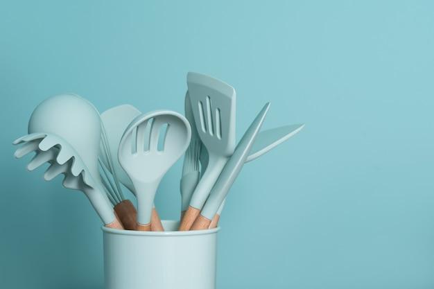 Green kitchen tools Premium Photo
