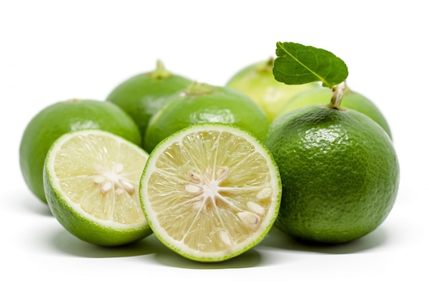 Green lime on white for food ingredients and cooking concept Premium Photo