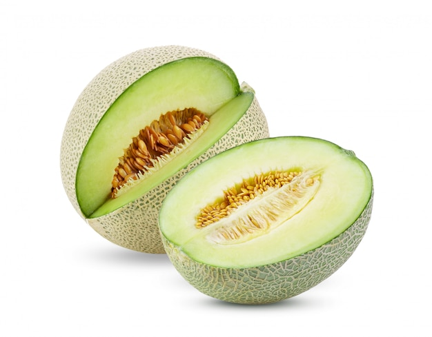 Green melon on white table. Premium Photo