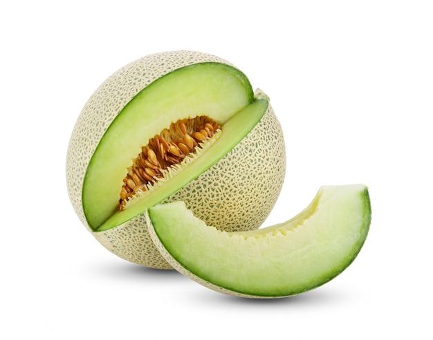 Green melon on white wall. Premium Photo