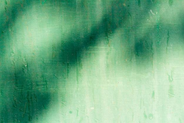 Green metal dirty textured background Premium Photo