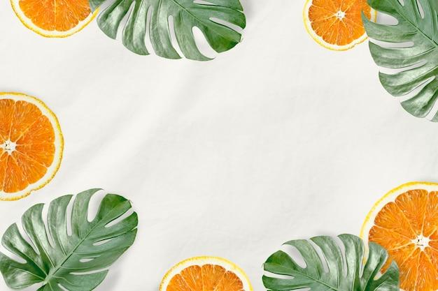 Foglie di monstera verde e arancia Foto Gratuite