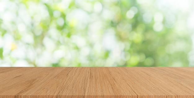Green nature with plank table Premium Photo