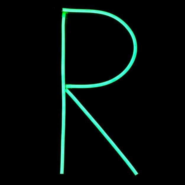 Green neon lights alphabet letters Free Photo