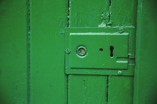 Green old door lock Free Photo