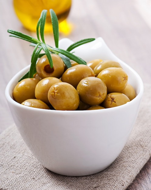 Green olives in bowl. Free Photo