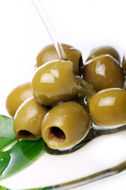 Green olives in oil Free Photo