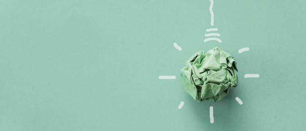 Green paper light bulb, corporate social responsibility, responsible business, eco friendly, sustainable living concept Premium Photo