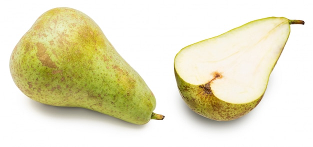 Green pears whole and cut in half (segments), freshly picked from the tree (variety conference, pyrus communis conference) fresh and raw. isolated Premium Photo