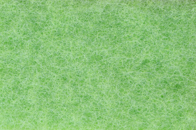 Green plastic fibers texture background. Premium Photo