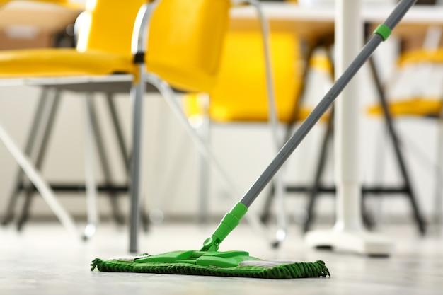 Green plastic mop Premium Photo