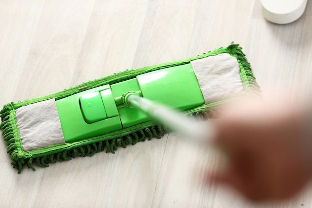 Green plastic mop Premium Photo