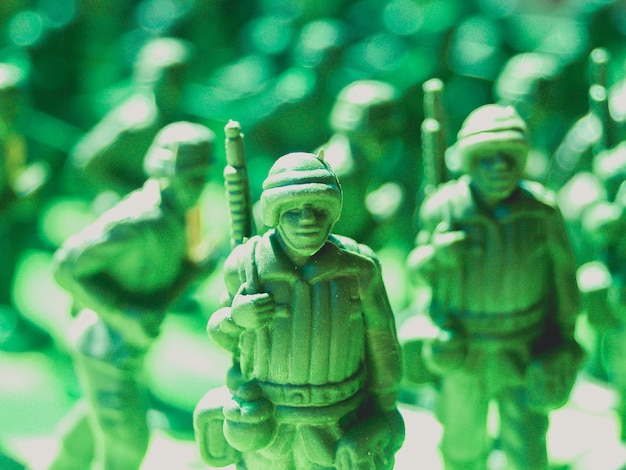 Green plastic toy soldiers Photo | Premium Download