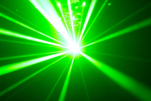Green and red laser in a nightclub. laser beams, club atmosphere Premium Photo