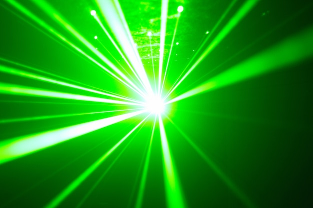 Green and red laser in a nightclub. laser beams on a dark background, club atmosphere Premium Photo