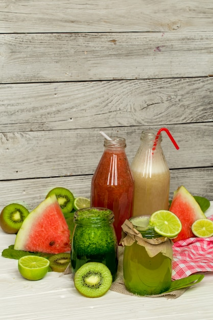 Green and red smoothies in a jar with lime, kiwi Premium Photo