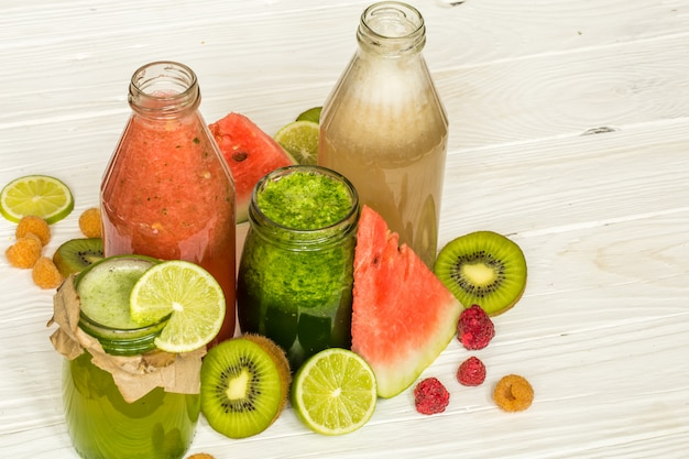 Green and red smoothies in a jar with lime Premium Photo