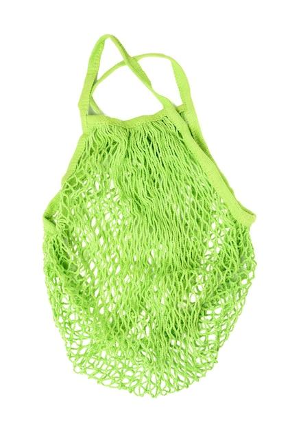 Зеленая многоразовая авоська, сотканная из ниток, изолирована на белом фоне, без отходов Premium Фотографии