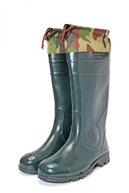 Green rubber boots on white background Premium Photo
