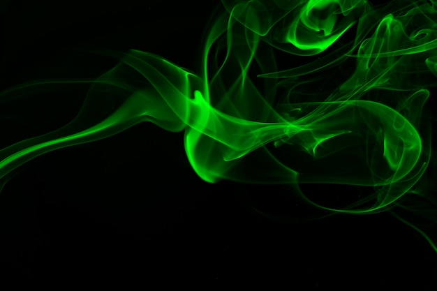 Green smoke abstract on black background, darkness concept Premium Photo
