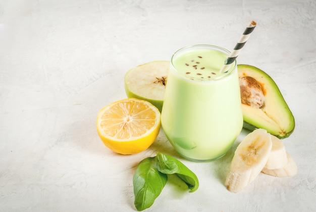 Green smoothies from yoghurt, avocado, banana, apple, spinach and lemon Premium Photo