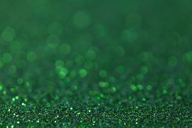 Green sparkling background from small sequins, closeup. brilliant backdrop Premium Photo