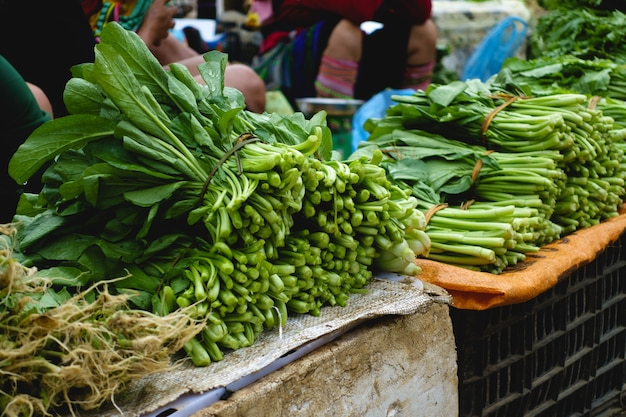 Green spinach leaves on street market Free Photo