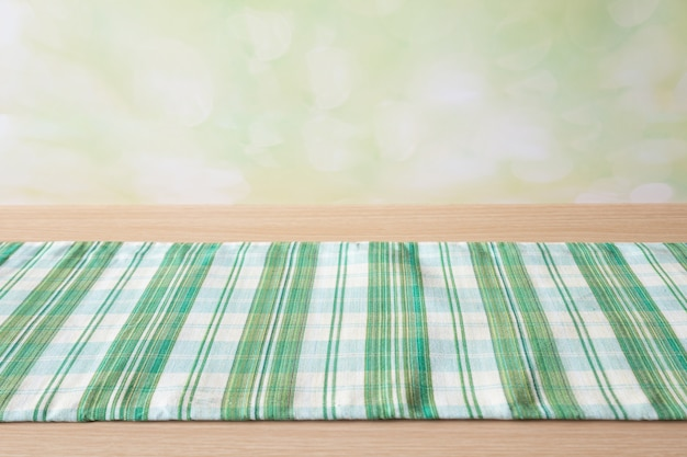 Green table cloth on wood table Premium Photo
