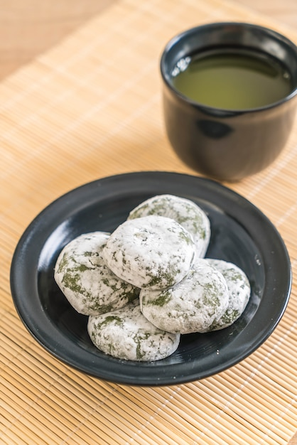 Green tea mochi with red bean Premium Photo