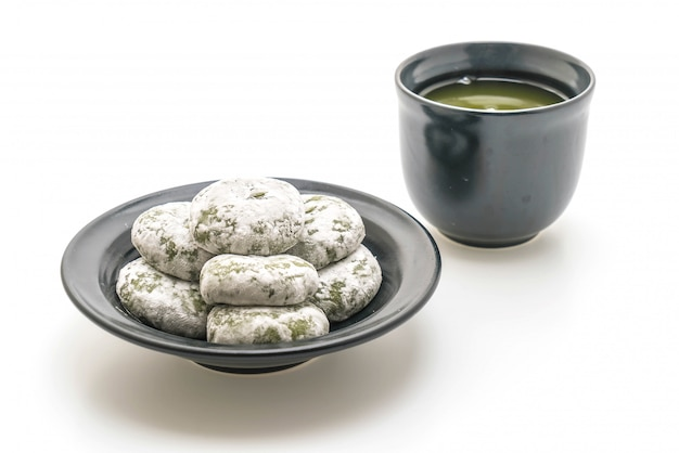 Green tea mochi with red bean Premium Photo