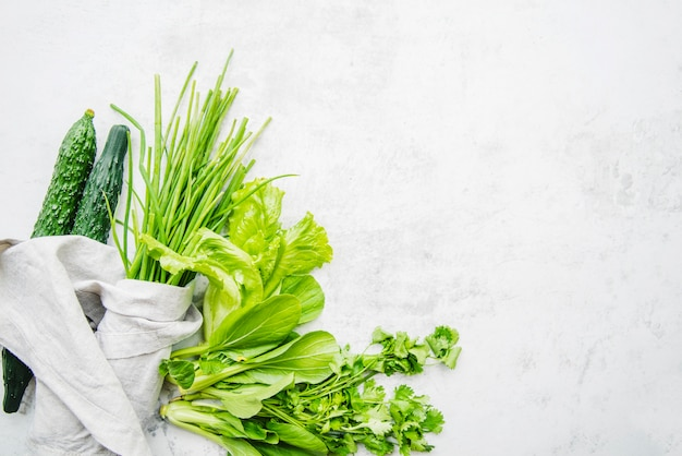 Green vegetable on marble background Free Photo