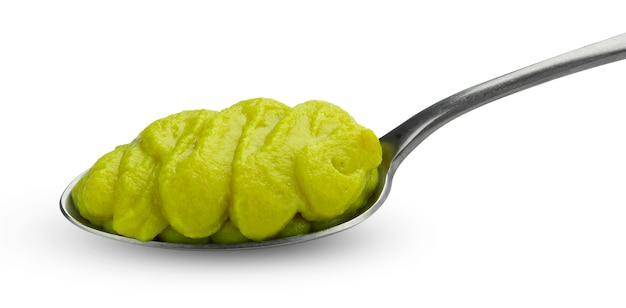 Green vegetable puree for baby food in spoon isolated on white Premium Photo