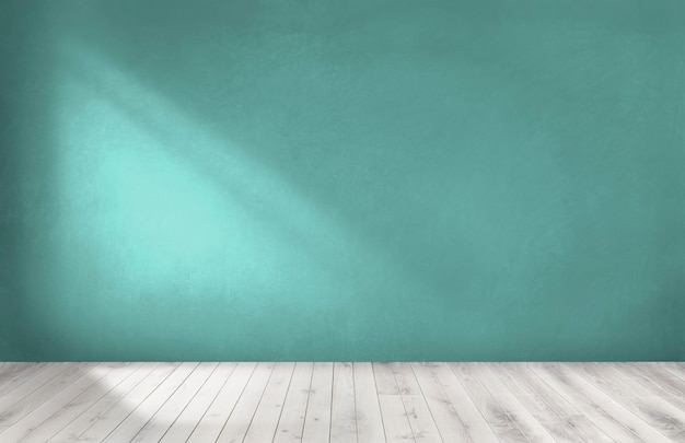 Green wall in an empty room with a wooden floor Premium Photo