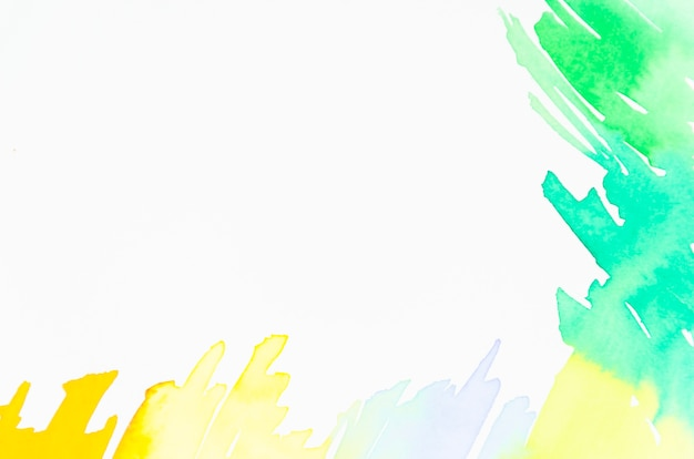 Green and yellow watercolor design on white backdrop Free Photo