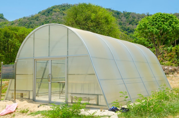 Greenhouse in the nature park outdoor with blue sky Premium Photo