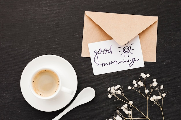 Greeting card beside cup of coffee Free Photo