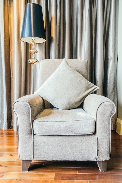 Grey armchair next to a lamp Photo | Free Download