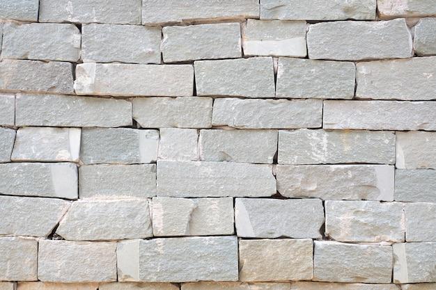 Grey brick wall and rough sand stone wall background Premium Photo