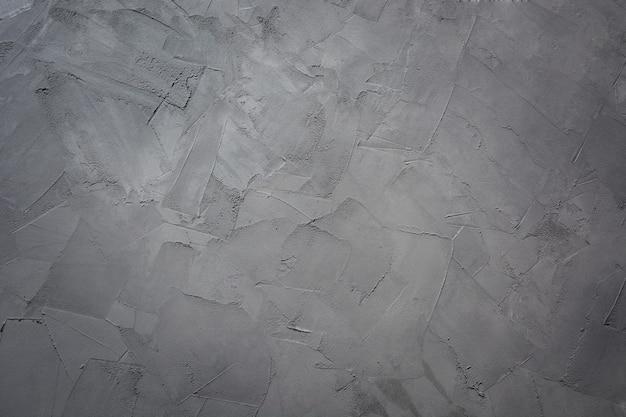 Серый бетонный фон для дизайна. текстура. шаблон. модный цвет ultimate grey 2021 года. Premium Фотографии