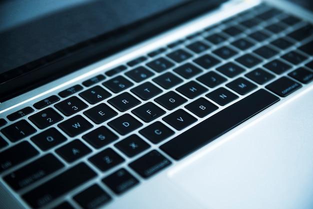 Grey laptop keyboard close up Free Photo