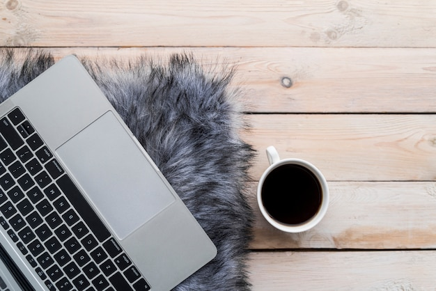 Grey laptop with coffee on wood table Free Photo