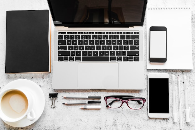 Grey laptop with office elements Free Photo