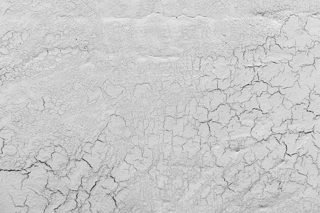 亀裂の背景を持つ灰色の石灰石膏 無料写真