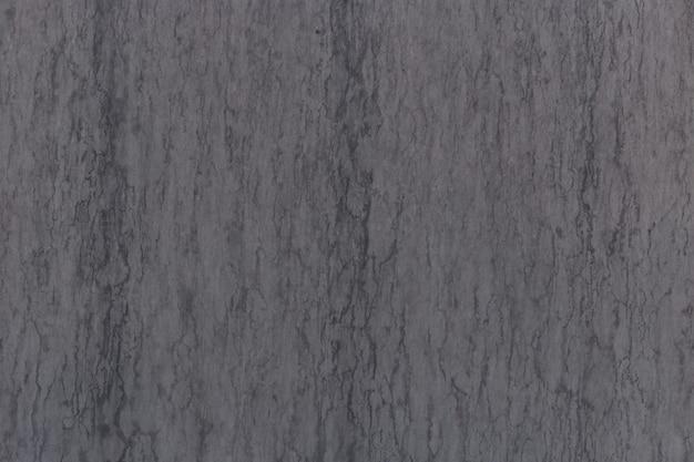 회색 대리석 질감은 미묘한 검은 색 결을 통해 쐈습니다. 추상적 인 배경. 프리미엄 사진