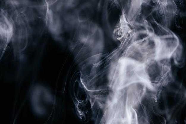 Grey smoke waves on black background Free Photo